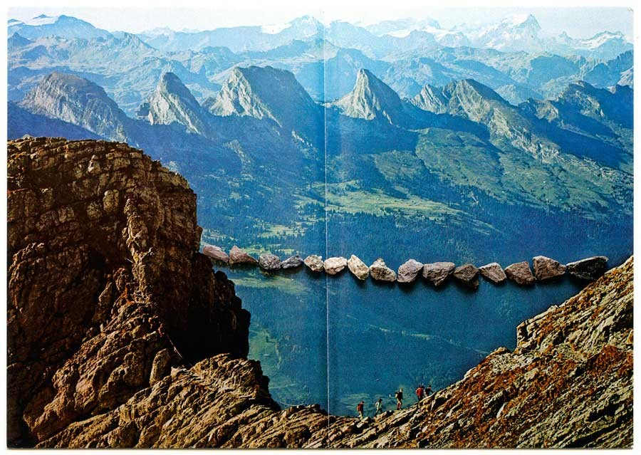 postcard swiss alps with bridge